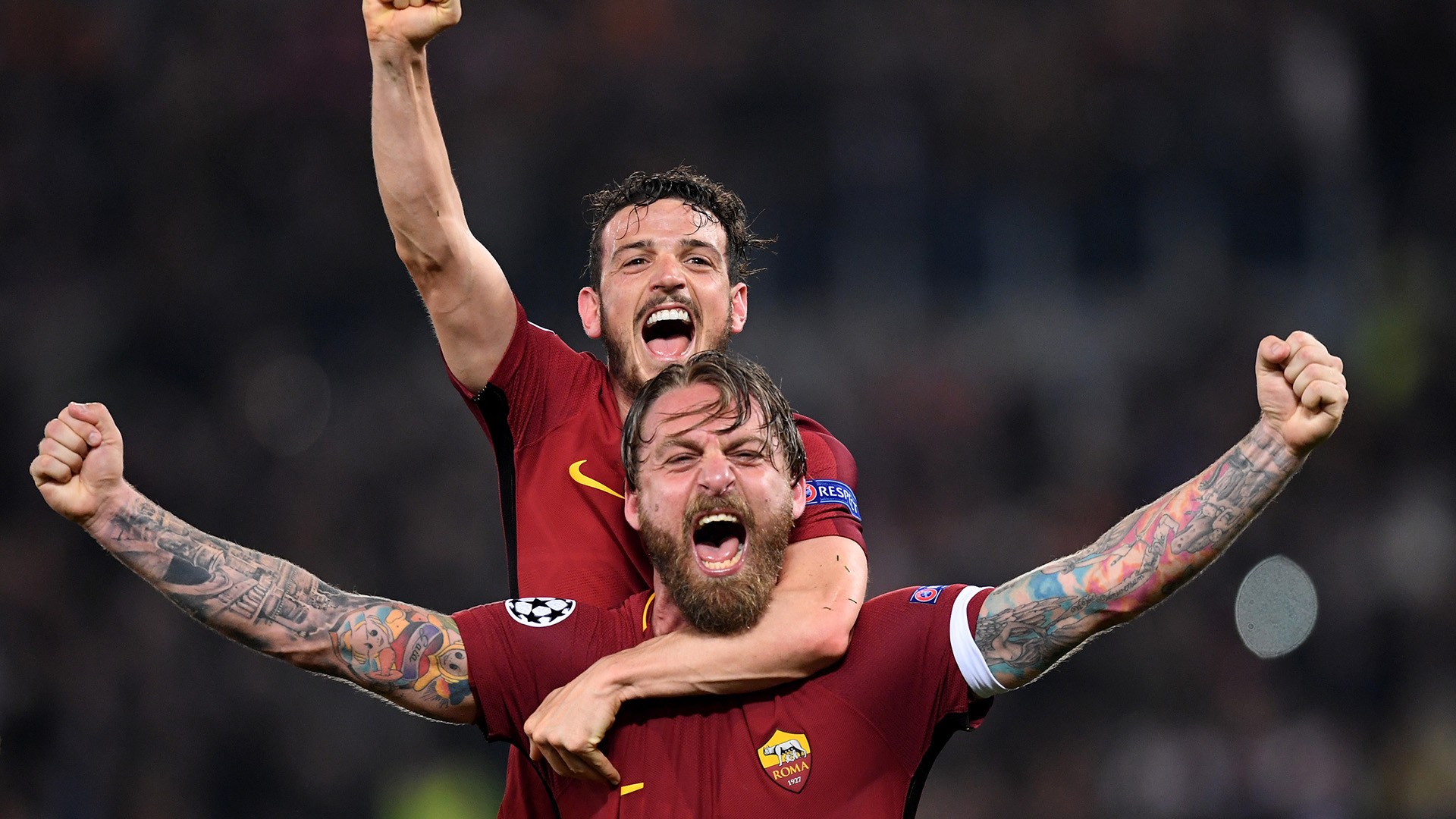 ROME, ITALY - APRIL 10: Daniele De Rossi of AS Roma celebrates his sides victory with Alessandro Florenzi of AS Roma after the UEFA Champions League Quarter Final Second Leg match between AS Roma and FC Barcelona at Stadio Olimpico on April 10, 2018 in Rome, Italy. (Photo by Michael Regan/Getty Images)